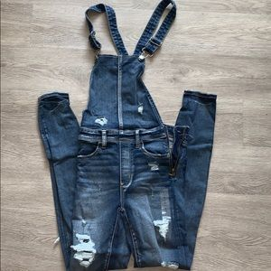 American Eagle blue overalls with distressed legs